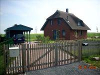 """Bild 3: Reetdachhaus """"Innisfree"""" in idyllischer Lage mit Blick auf das nahegelegene Haff"""