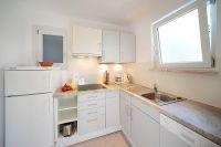 Separate Küche, großer Kühlschrank mit Gefrierfach, Geschirrspülmaschine. - Bild 3: Haus Rosengarten/ Marcher/ Typ Family