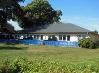 Das Ferienhaus mit den Ferienwohnungen Typ 3 steht nur ca. 50m vom Bodden entfernt und Sie haben einen weiten Blick auf das Wasser. Auf der Südterrasse mit Boddenblick können Sie es sich gemütlich machen, Frühstüchen, Grillen... - Bild 3: Erholung am Wasser - Ostseehalbinsel Darss mit Hund - Angeln