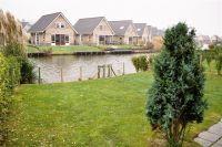 Bild 6: Haus Birgit mit eingezäunten Garten am Ijsselmeer für Urlaub mit dem Hund