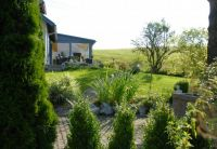 Außenansicht mit Blick von Sauna. - Bild 15: Ferienhaus Allgäuperle, Perle in malerischer Landschaft des Allgäus.