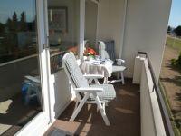 Der Balkon ist zur Seeseite ausgerichtet und hat eine Markise. - Bild 15: Groemitz-Villa am Meer - Seeblick Ferienwohnung