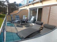 Terrasse mit Sitzecke und Liegen - Bild 3: Fewo 80 m zum Strand der Schaabe in Juliusruh.