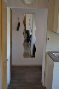 Eingangsbereich mit Garderobe - Bild 12: Ferienwohnung Bahnkolk I in Norddeich