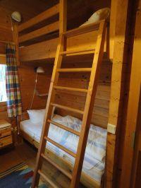 Einzelbett und Hochbett im Kinderzimmer. - Bild 6: Urlaub im Blockhaus - Ruhe und Natur für Mensch und Hund